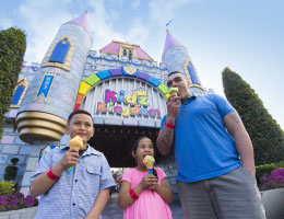 Family in front of Kidz Kingdom with ice creams